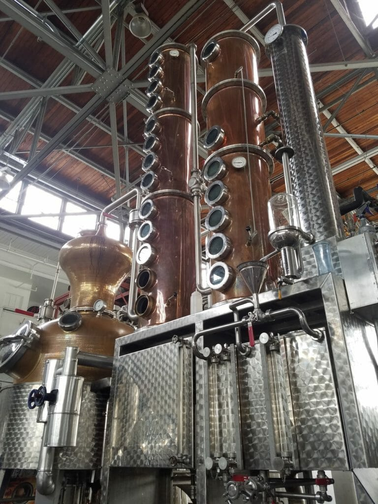 Three stills in a warehouse