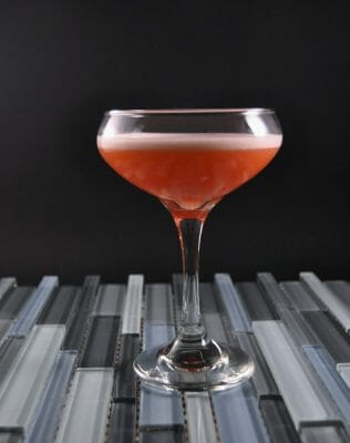 Pinkish cocktail with gray background