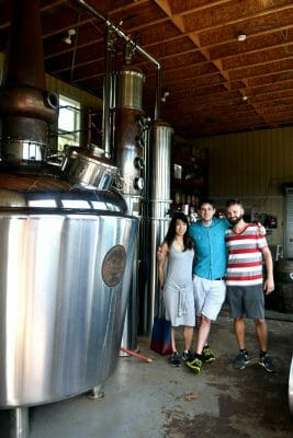 Three people next to stills