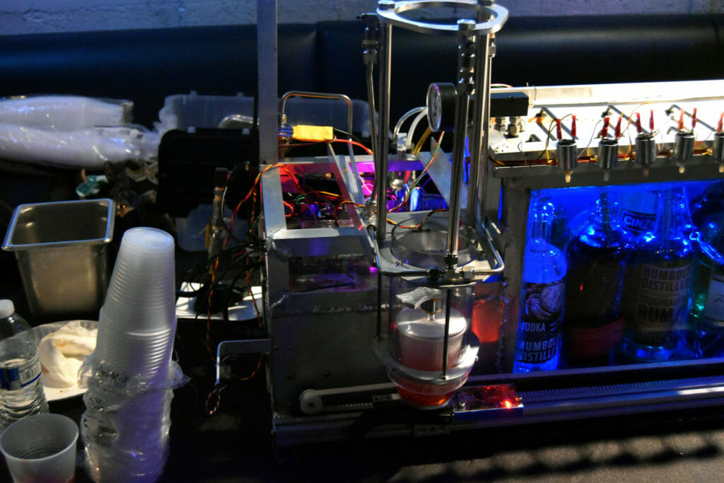 Cocktail Robot next to set of blue bottles