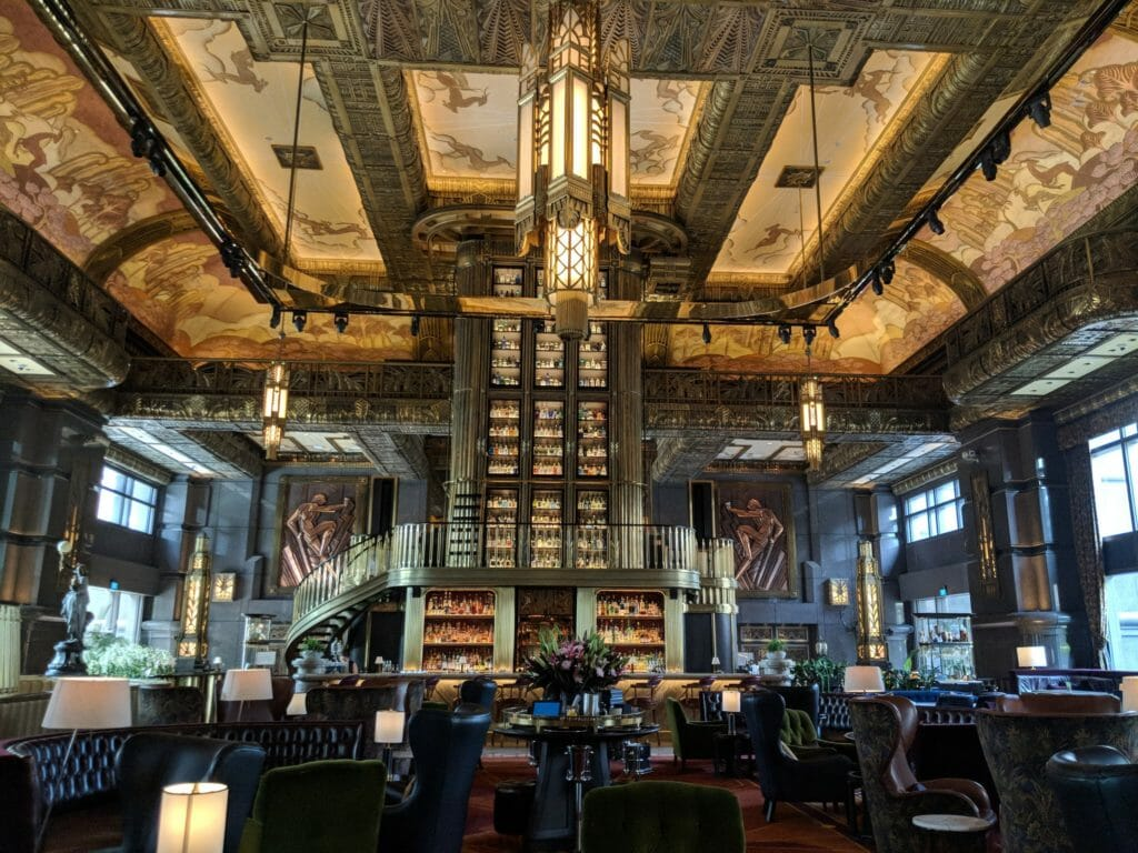 Beautiful bar in the center going up to the ceiling with light coming in from windows on all sides