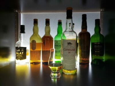 Several bottles of whiskey backlit