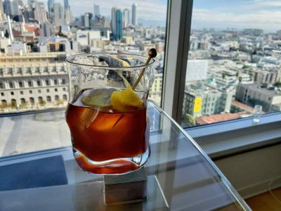 Cocktail with city in the background