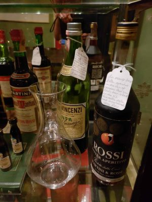 Old Amaro bottles with glass in front