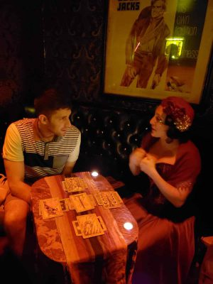 Woman and man with tarot cards