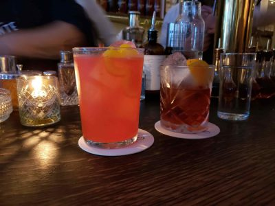Two cocktails ontop of coasters
