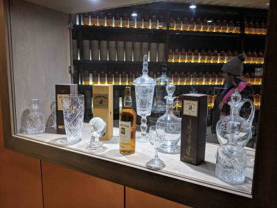 Tasting area with decanters and many bottles behind