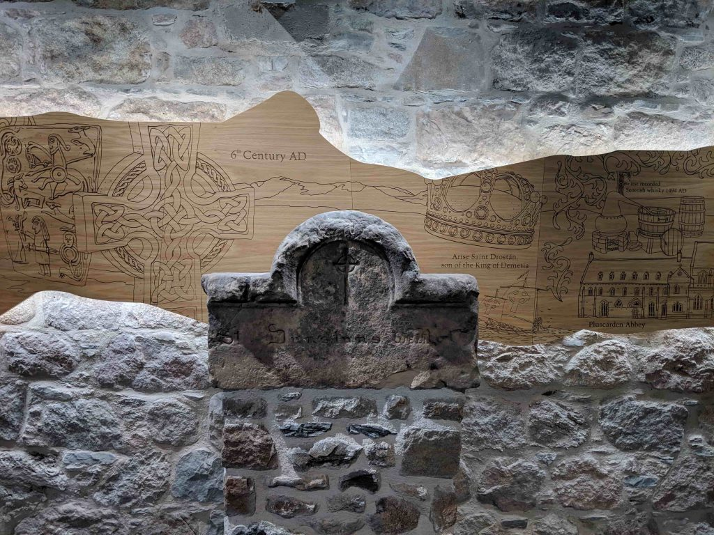 Mural with history of the distillery with stone in middle