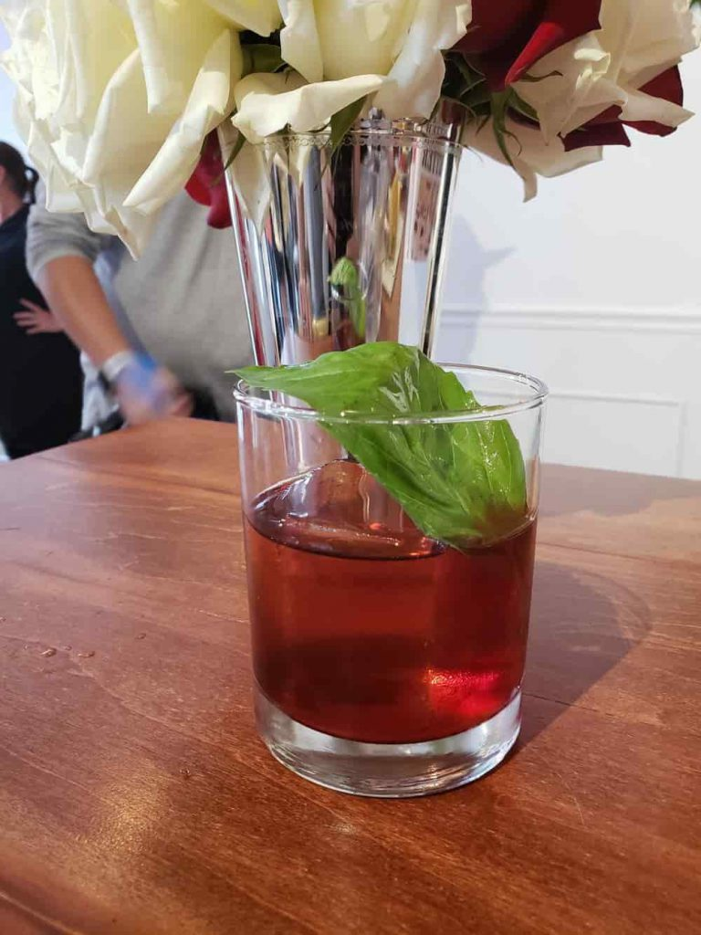 Negroni in front of flower vase