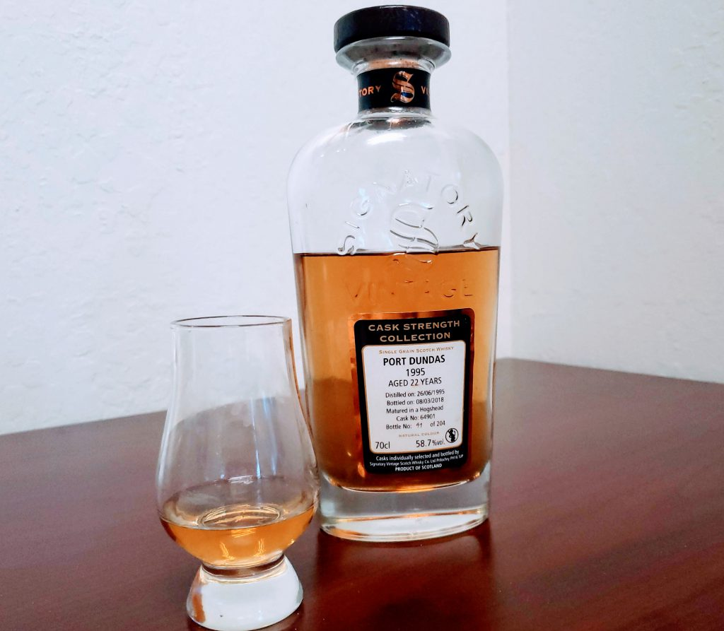 Whisky bottle next to pour of whisky