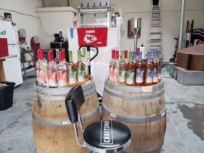 Barrels topped with bottles