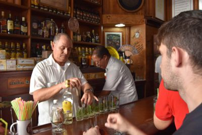 Multiple mojitos lined up on a bar