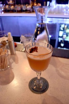 Cocktail with orange and cream head