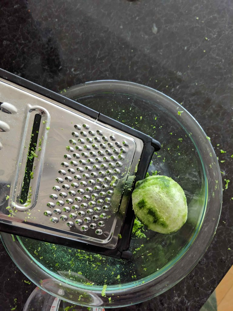 Lime next to microplane grater